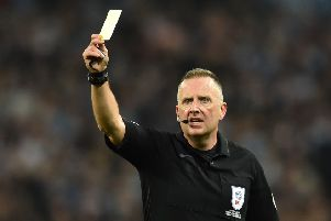 Referee Jonathan Moss shows a yellow card to a player during the English League Cup final football match between Manchester City and Chelsea at Wembley stadium in north London on February 24, 2019. (Photo by Glyn KIRK / AFP) / RESTRICTED TO EDITORIAL USE. No use with unauthorized audio, video, data, fixture lists, club/league logos or 'live' services. Online in-match use limited to 75 images, no video emulation. No use in betting, games or single club/league/player publications. /         (Photo credit should read GLYN KIRK/AFP/Getty Images) 775299801