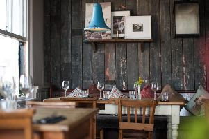 The spacious dining room has a relaxed and rustic feel