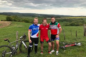 Left to right: Rob Fenwick, Jamie Tyson and Alex Lord at Ditchling Beacon during a recent training ride