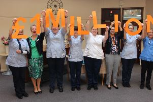 Staff at St Catherine's Hospice celebrate reaching the 1 million mark
