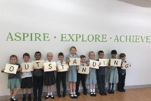 Pupils celebrate their outstanding Ofsted award
