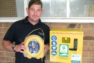 Max Talbot, groundsman and first aider at Surrey & Sussex Crematorium with the defibrillator