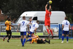 Luke Glover gathers the ball at full stretch.
