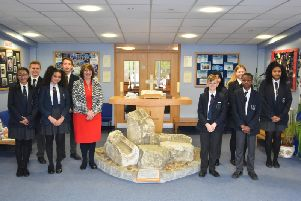 Headteacher Rev. Chrissie Millwood and students at Holy Trinity School