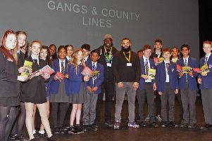 DM19111631a.jpg. Schools day to tackle youth issues/gangs etc at The Hawth, Crawley. Some of the pupils from Hazelwick school and Ifield Community College with speakers Jacob Riggon, left and Cairo Coombs. Photo by Derek Martin Photography.