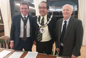 Town mayor Danny Favor with new association chairman Nick Hodges and Ken Averill, who has stepped down from his role, at the AGM of the East Grinstead Town Twinning Association on November 22