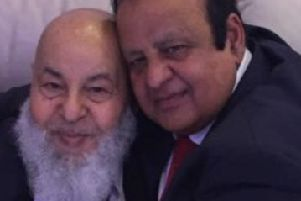 Mohammad Azim (left) with his younger brother Amin Mirza (right)