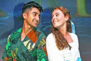 Peter Pan at The Capitol, Horsham. Anthony Sahota as Peter and Rebecca Lafferty as Wendy. Photo by Derek Martin