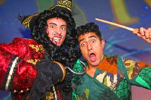 Nicholas Collier as Captain Hook and Anthony Sahota as Peter Pan. Photo by Derek Martin, dm1994779a