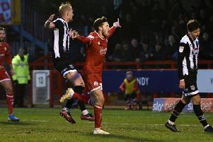 Ashley Nadesan celebrates scoring the winner in thriller against Grimsby Town. Photo: Steve Robards