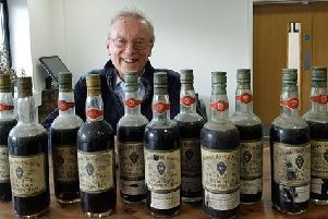 Charles Metcalfe with the bottles of rum he inherited from his late father SUS-200220-161646001