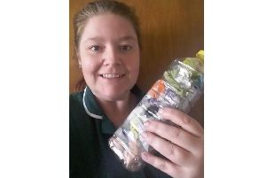 Rebecca Brooks holds an ecobrick she made