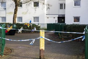 Seven bunches of flowers and a blue heart-shaped balloon have been left by the railings at the scene of a Northampton murder. Pictures: Kirsty Edmonds.