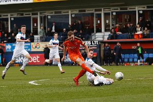 Joe Bunney produces a superb challenge on Luton's Jack Stacey. Picture: Liam Smith