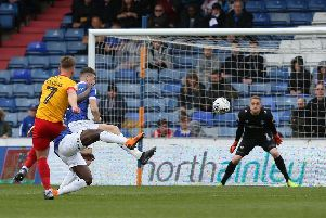 Sam Hoskins lashes into the top corner to bring Cobblers level against Oldham. Pictures: Pete Norton
