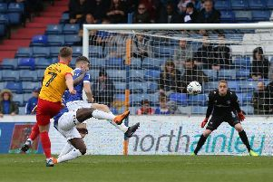 Sam Hoskins smashes into the top corner against Oldham. Picture: Pete Norton