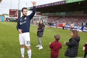 John-Joe O'Toole acknowledges the Cobblers supporters following the final home game of the season against Yeovil last month (Picture: Pete Norton)