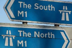 A crash involving a car and a lorry has closed two lanes on the M1