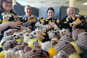 Detective Sergeant Jen Castle, Northamptonshire police, fire and crime commissioner Stephen Mold and two other officers with just some of the Bobby Buddies donated to Northamptonshire Police