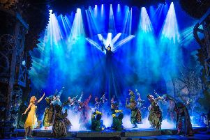 Elphaba (Nikki Bentley) defies gravity in Wicked
