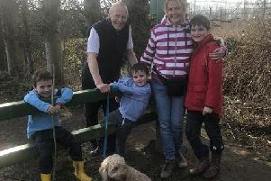 Judith and Steve with their grandchildren.