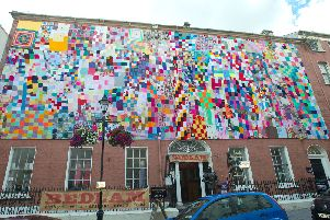 The quilt assembled by Aine Clarke to create what is believed to be the largest quilt in Ireland, for the launch of August Craft Month. The children's wear designer worked with hundreds of people including children and adults up to 100 years old . The 60 feet long  by 20 feet high piece of art is on display outside Bedlam in Pump Street in Derry~Londonderry which is the first UK City of Culture. Further information on craft month is available at www.craftni.org PIcture Martin McKeown. Inpresspics.com. 30.7.13