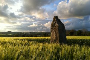Standing stone in a barley field near Ballougrey by Patrick McCloskey.