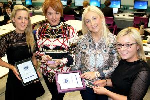 Teachers at St Columb's College check out the school's new mobile app. From left are  Leane McShane, Mary Jo O'Carolan, Stacey Beattie and Leanne McErlaine.
