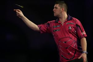 Daryl Gurney throws during Saturday's defeat to John Henderson