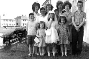 Photo taken by Hugh's father (also Hugh) left to right: Mary Gallagher (mother), Mary, Helen, Kathleen, Margaret, Mura, Ann, and Patricia, Hugh, Liam and Eugene.