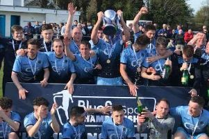 Institute players celebrate winning the Bluefin Sport Championship title.