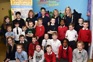 Staff members, from left, Ashling Riddles, Louise Stevenson, manager, Leanne McGahan, administrator, Laura Watson and Sarah Doherty, pictured with children who enjoyed returing to the newly refurbished Club United Out of School Club. DER1618-105KM
