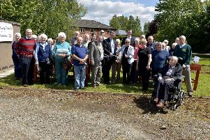 Pictured at St Peter's Church, Culmore Road, at the launch of a cross-community flower bedding project are the parishioners, councillors, representatives from the Men's Workshop who provided the flower boxes and representatives from Altnagelvin Garden Centre who provided the plants. Included in the picture are Councillor Maol�osa McHugh, Mayor of Derry City and Strabane, The Ven. Robert Miller and Rev. Katie McAteers, cutting the ribbon, and Ivan Cooper, founding member of the SDLP. DER2018GS062