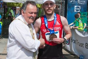 City of Derry Spartans' Mark Mullan who finished fourth pictured with Mayor of Derry and Strabane District Council, Maolosa McHugh.