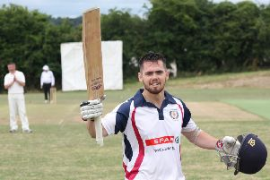 Newbuildings Stephen Wallace acknowledges the applause after securing his century in their win over Killyclooney.