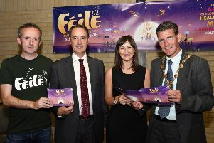 The Mayor, Councillor John Boyle pictured with, from left, Gareth Stewart, organising committee, Mark Browne, Deputy Permanent Secretary for Northern Ireland, and Linsey Farrell, Programme Director for the Urban Villages Initiative, funders, at the launch of Feile 2018 in the Pilots Row Centre. DER3018-124KM