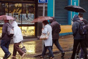 People running in the rain