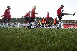 Derry City players warm up prior to their FAI Cup quarter-final tie Bohemians at the Brandywell.