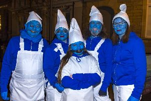 The Brannigans dressed in Smurf costumes for Halloween night. DER4418GS003