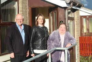 Sinn Fein Councillor Caoimhe McKnight and Lewis and Sandra McClenaghan outside their Leafair Park home.