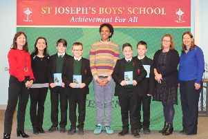 Author and performance poet Joe Coelho visits St Joseph's Boy's School  (L-R Liz Canning (BookTrust NI), Mrs McLaughlin (Librarian),Year 7&8 Pupils from St Joseph's, Joseph Coelho, Mrs Brady, and Josie Cusack, Education Library Service Manager)