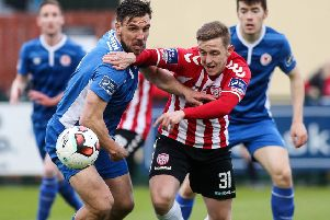 Striker Mikhail Kennedy tussles with the then St. Patrick's Athletic defender Gavin Peers.