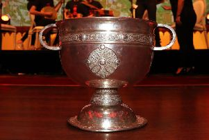 The Sam Maguire Cup which is presented to the winning county of the All-Ireland Senior Football Championship.