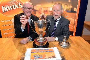 Stephen Elliott and  Brian Irwin make the draw for the Nutty Krust Floodlit Cup 2019