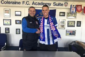 Coleraine manager Rodney McAree welcomes new signing Dean Shiels to the club.
