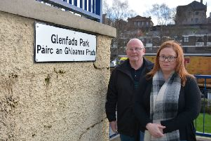 Councillors Kevin Campbell and Sharon Duddy at signs erected at Glenfada Park in the Bogside