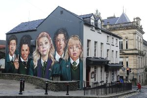 Press Eye - Belfast - Northern Ireland - 27th January 2019.'Photo by Lorcan Doherty / Press Eye.'Derry graffiti artists UV Arts painting a mural of the lead characters of the Channel 4 comedy 'Derry Girls' on the wall of Badger's Bar, Orchard Street, Derry, to celebrate the return of the hit comedy.