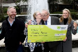 Charlie Meehan, 84, from Manorcunningham, one of those winners is pictured with his wife Ruby and Son Niall and daughter Ann when he collected his winnings from the National Lottery HQ. Pic: Mac Innes Photography