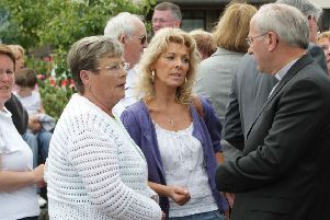 Bloody Sunday relatives Regina McLaughlin, daughter of Gerard McKinney, and Kay Duddy, sister of Jackie Duddy speaking with the President of the Methodist Church Rev Paul Kingston back in 2010. (Photo Lorcan Doherty / Presseye.com.)