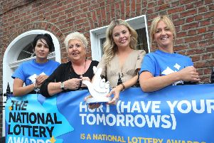 Derry Girl Saoirse Monica Jackson (Erin) visiting National Lottery funded HURT (Have Your Tomorrows) family support group last year with from left, staff members Tina Burns, Sadie O'Reilly and Pauline McCloskey.